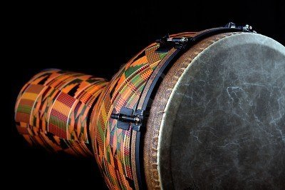 5549802-an-orange-african-or-latin-djembe-conga-drum-isolated-on-black-background-in-the-horizontal-format-w